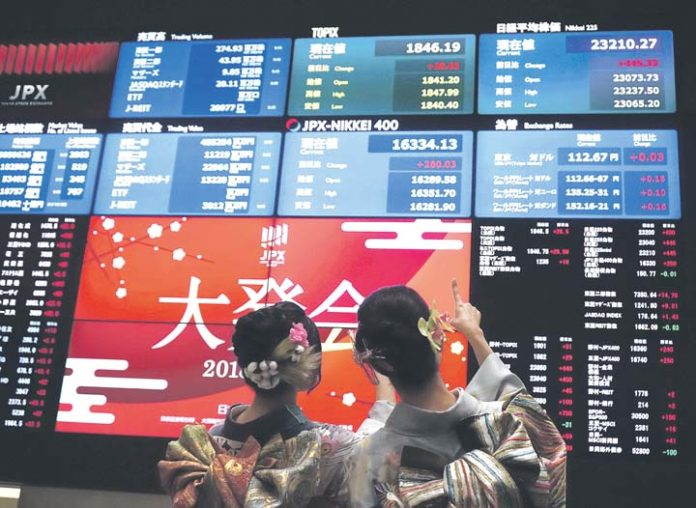 Japan leads Asian shares higher, buoyed by Wall Street records