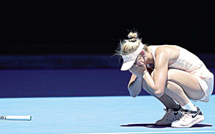 Wozniacki saves two match points, advances to 3rd round