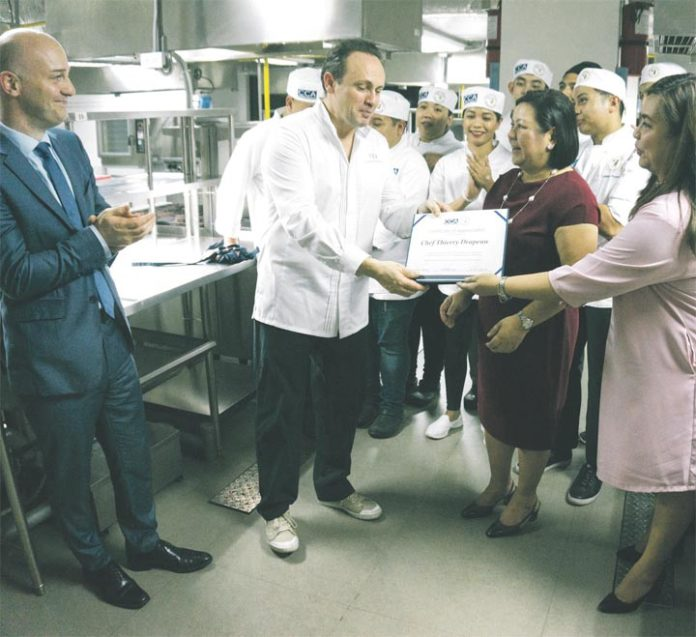 Michelin starred chef brings best french flavors in cooking in photo chef thierry drapeau receives a certificate of appreciation from cca executives yadclub Images