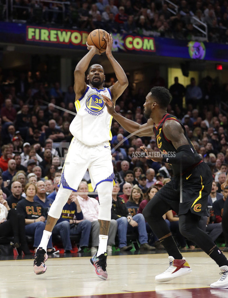 8fcc10ea Golden State Warriors' Kevin Durant shoots against Cleveland Cavaliers'  Jeff Green during the first half of Game 3 of basketball's NBA Finals ...