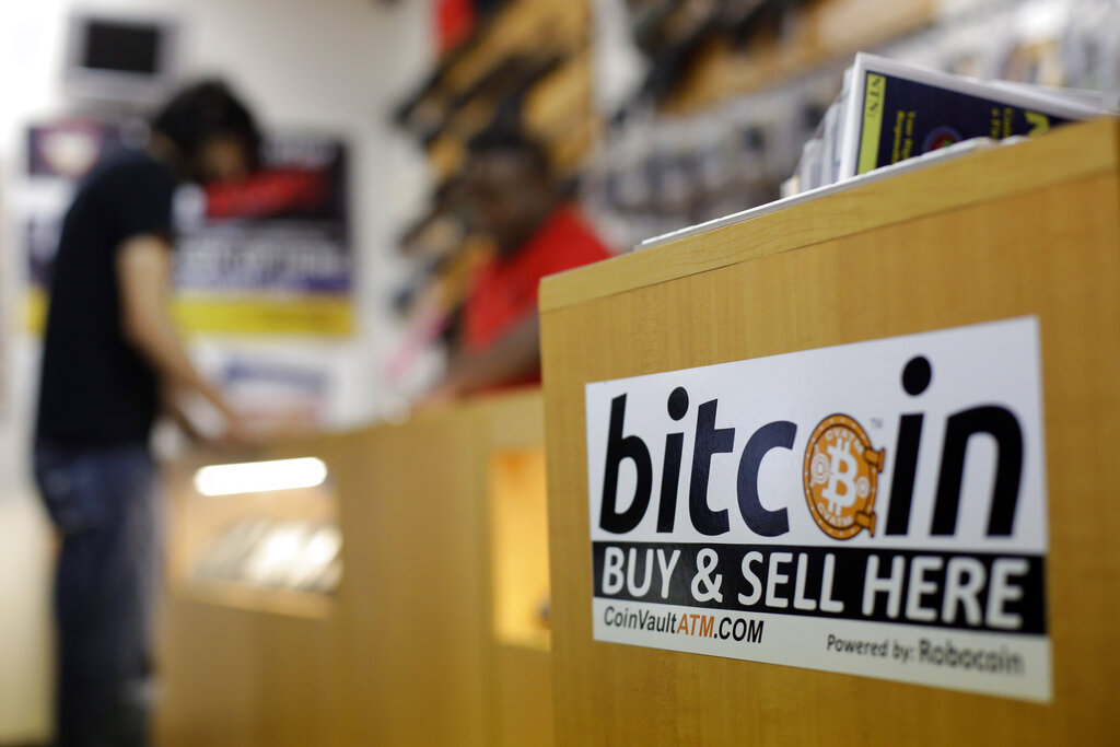 Bitcoin tops $40,000 on continued monetary easing